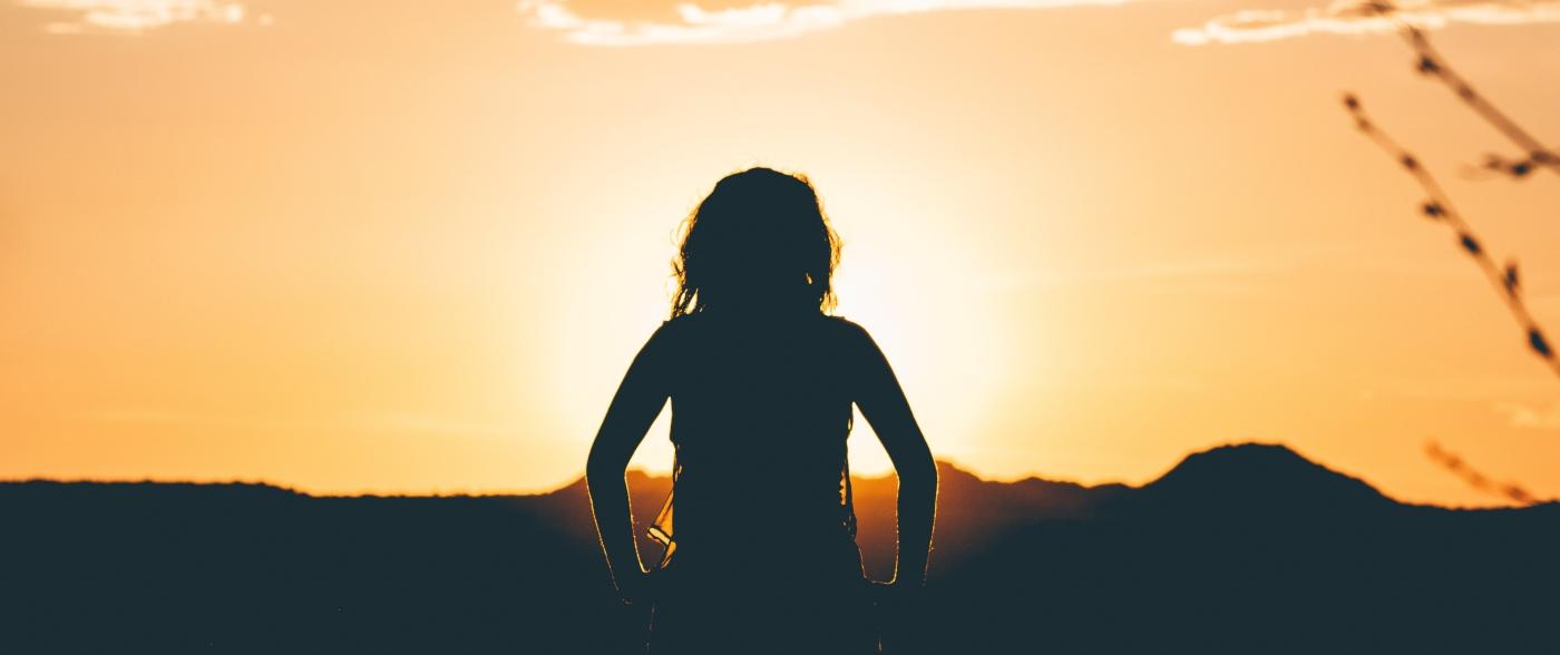 Girl looking at the horizon.